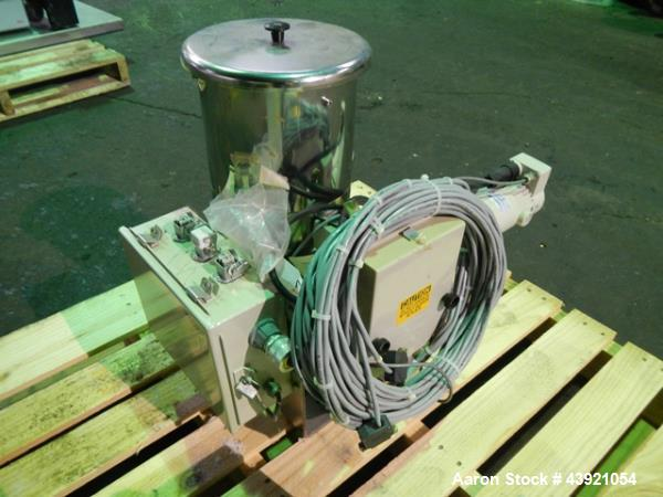 Used- Ktron Gravimetric Feeder, Model F-1. Stainless steel construction, twin screw with agitated feed hopper, scale rated 2...
