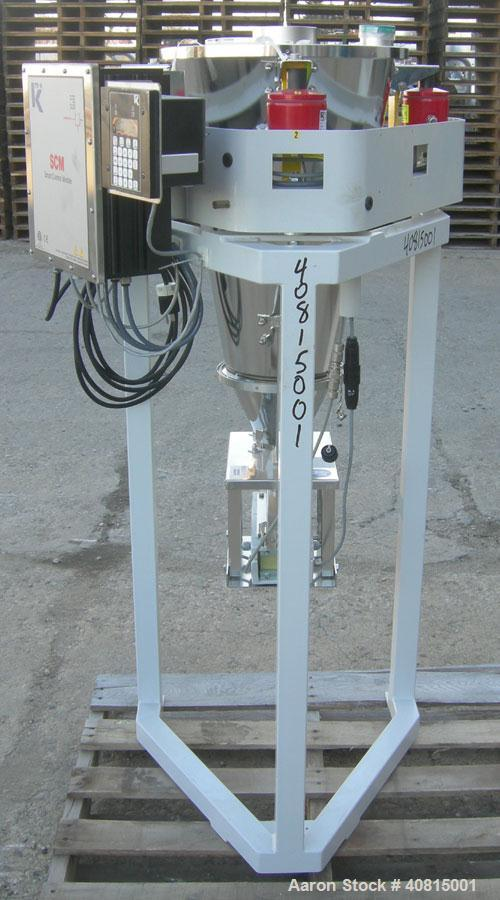 Used- K-Tron Vibratory Feeder, Model K2MLKV2, 304 Stainless Steel.  Rated approximately 100 pounds per hour.  Includes a top...