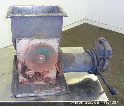 """Used- K-Tron Feeder, 304 Stainless Steel. Approximate (2) 1"""" diameter x 12"""" long screws. Agitated feed hopper. Driven by a 1..."""
