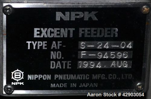 Used-NPK Excent Feeder, Model AF-S-24-04, Stainless Steel. Driven by a 1/2hp, 3/60/460 volt, 1740 rpm motor.