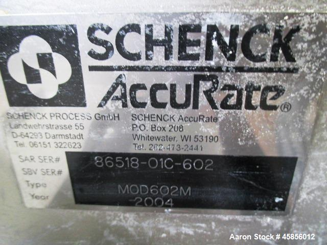 "Used- Schenk Accurate Volumetric Feeder, Type MOD602M. Stainless steel screw and spout, 2.25"" diameter x 21"" long spout with..."