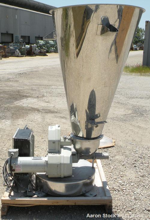 Used- K-Tron Volumetric Twin Screw Feeder, 304 Stainless Steel. Approximate (.07) cubic feet an hour output.Approximate scre...