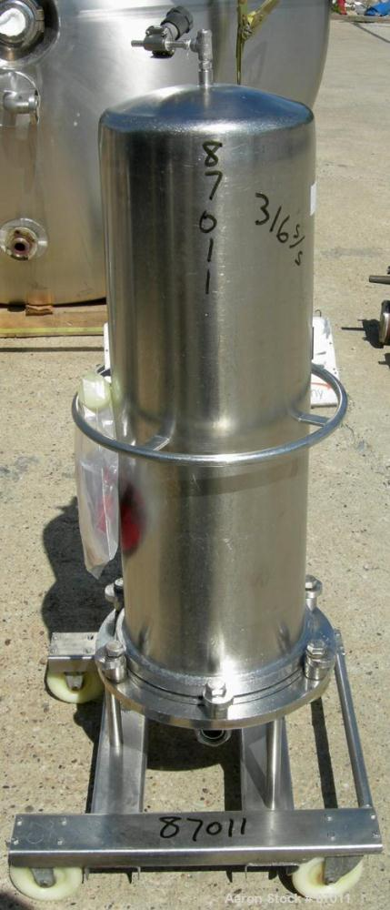 "Used- Valex Filter Housing, 316 Stainless Steel. 12-3/8"" diameter x 35"" straight side. Dish top, flat bolt-on bottom. 1-1/2""..."