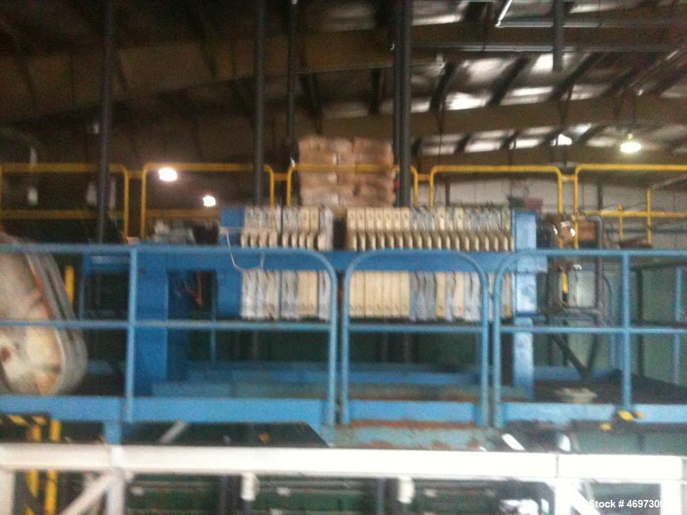 Used- JWI Filter Press. 10 cubic foot, elevated stand for roll of box. Press has 800 mm plates, 23 plates plus head and tail.