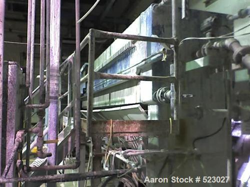 """USED: JWI poly filter press, 85 frames 42"""" x 42"""", year 2001. Catwalkand 4"""" diaphragm pump, conveyor system underneath to a c..."""