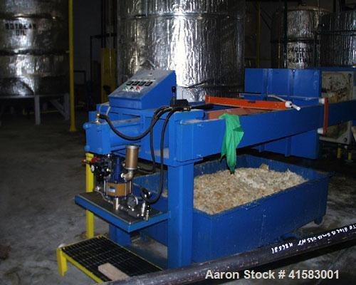 Used-Met-Chem Filter Press, 20 cubic feet, 1000 mm. Auto hydraulic closer, auto pump control with dumpsters.