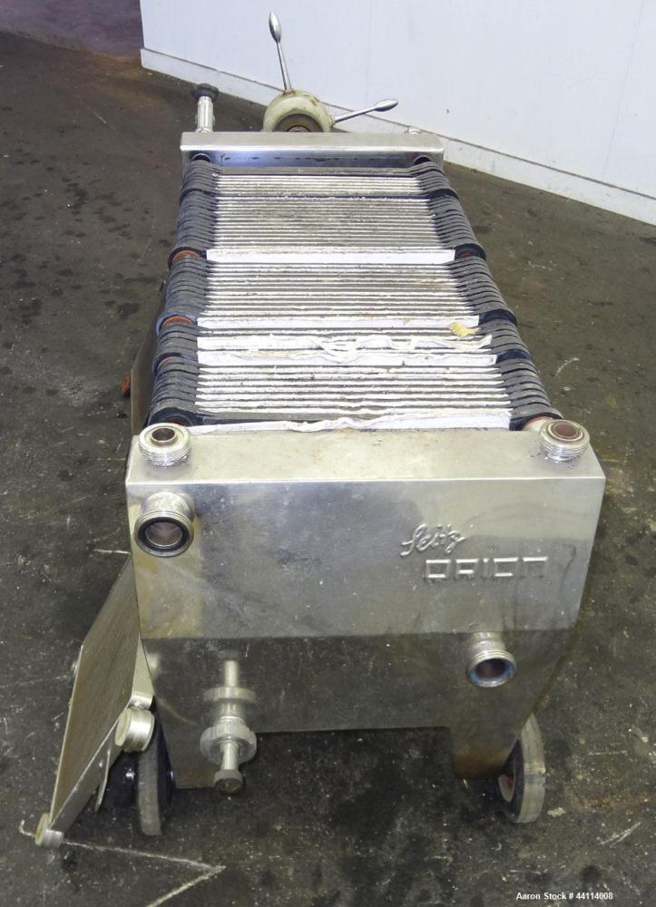 "Used- Seitz Werke Polishing Press, Type 40/60. Has (57) 15"" X 15"" plastic Plates, (1) head, (1) tail that are stainless stee..."