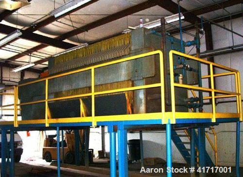 """Used-Trent Filter Press. Press consists of (36) 1500 mm (approximately 59"""" x 59"""") polypropylene filter plates. 60 cubic feet..."""