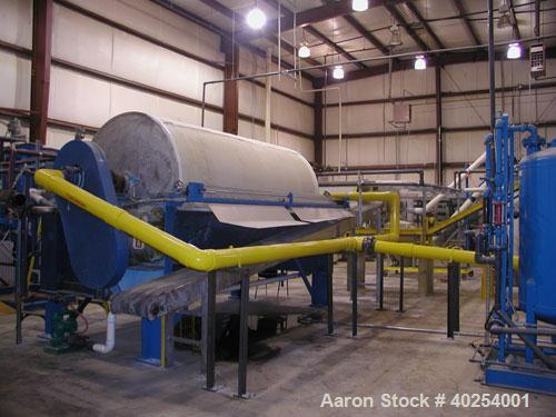 Used-Used: Alar Auto-Vac Filter, model 6120. The dewatering system consists of a precoat slurry tank, a screw conveyor for c...