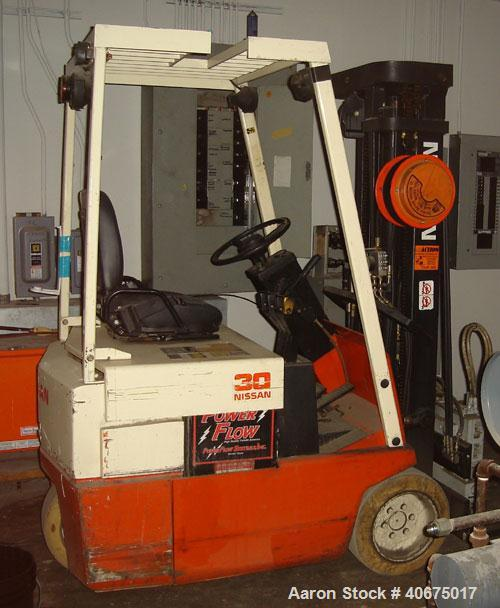 Used-Nissan forklift, model 30, battery, with charger.