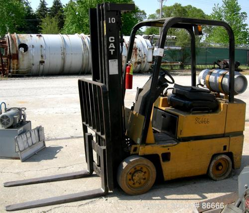 "USED- Caterpillar LP Forklift, Approximate 3000 Pound Capacity, Model T30D. Solid tire, triple mast, 40"" long forks."