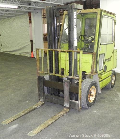 Used-Clark 6000 lb  LP Fork lift. Needs repairs. Model 743. Serial Number 883025 2 Stage Mast. Solid Tire