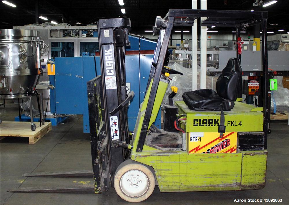 """Used- Clark Electric Fork Lift/Truck, Model TM15. 9852 Hours. 2575 capacity. 42"""" long forks. Has side shift. Battery operate..."""