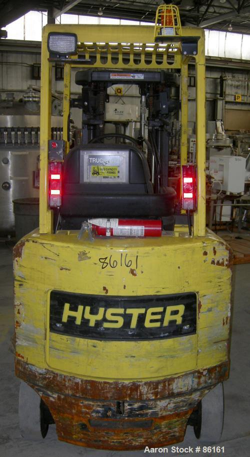 USED: Hyster electric forklift, approximate 5000 pound capacity, model E50XM. Solid tire, triple mast, 5 degree back tilt, s...