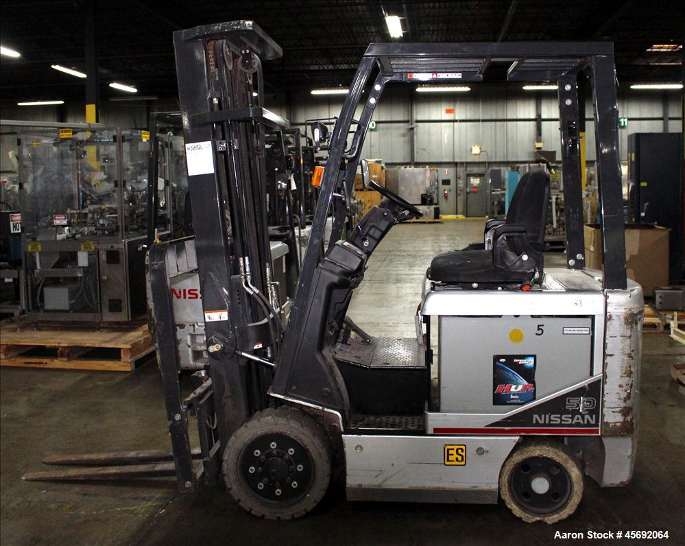 "Used- Nissan Electric Fork Lift/Truck, Model CP1B2L25S. 9385 hours. Maximum 3450 lbs capacity. 42"" long forks. Has side shif..."