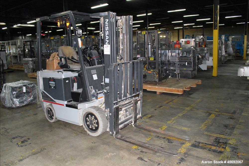 "Used- Nissan Electric Fork Lift/Truck, Model MCP1B2L25S. 2203 hours. Maximum 4400 lbs capacity. 42"" long forks. Maximum 187""..."