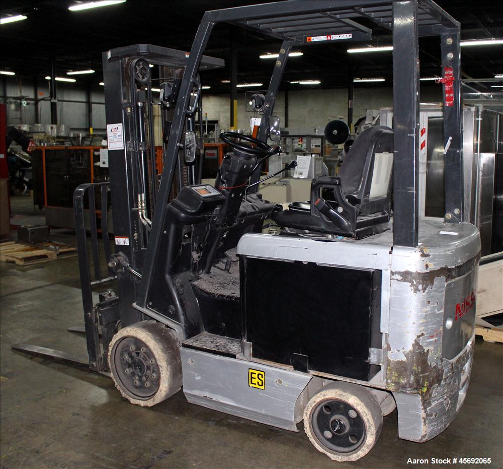 "Used- Nissan Electric Fork Lift/Truck, Model CP1B2L25S. 10485.5 hour. Maximum 4400 lbs capacity. 42"" long forks. Maximum 187..."
