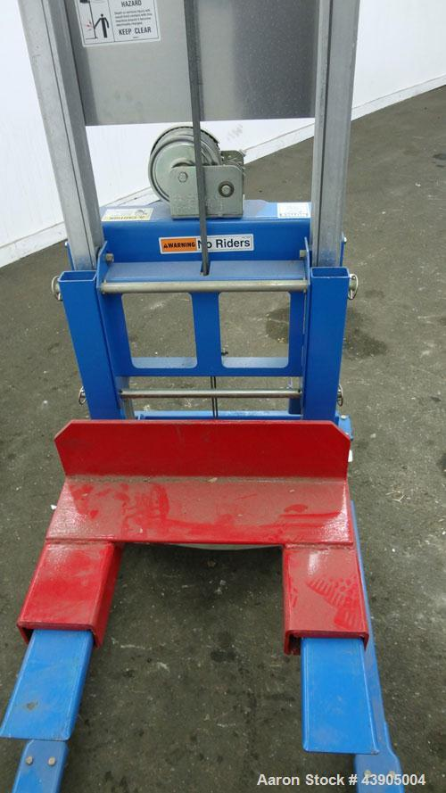 Used- Genie GL Lift. 350 Pound lifting capacity. Aluminum and carbon steel frame with casters.
