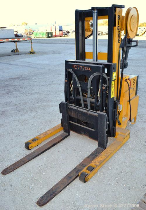 Used- Big Joe Electric Walk Behind Reach Truck, Model PDR-20-106. Lifting capacity 2000 pounds at 24'' center. Lift range 10...