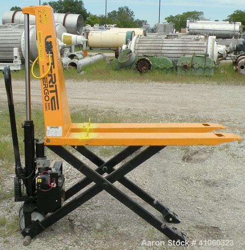 Used- Lift-Rite Ergonomic 3000 12 Volt Electric/Manual Portable Scissor Lift, model RG30E, carbon steel. 3000 pound capacity...
