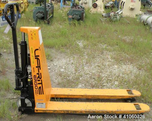 Used- Lift-Rite Ergonomic 3000 12 Volt Electric/Manual Portable Scissor Lift, model RG30E, carbon steel. 3000 pound capacity...