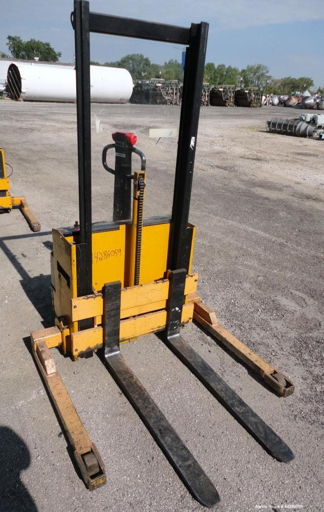 "Used- Multition MCI Corp Electric Walk Behind Straddle Stacker, 2000 Pound Capacity, Model SW20-63. Maximum lift height 63"",..."