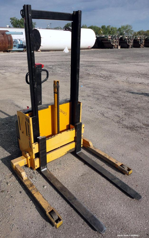 """Used- Multition MCI Corp Electric Walk Behind Straddle Stacker, 2000 Pound Capacity, Model SW20-63. Maximum lift height 63"""",..."""