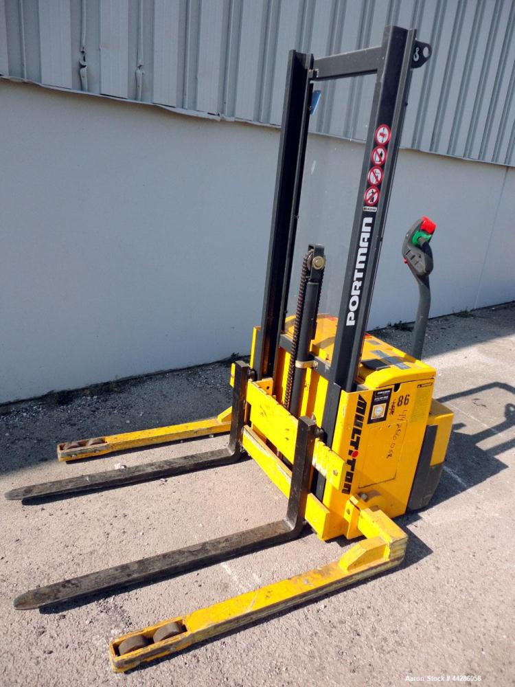 """Used- Multition MCI Corp Electric Walk Behind Straddle Stacker, 2204 Pound Capacity, Model SW22-62. Maximum lift height 62"""",..."""