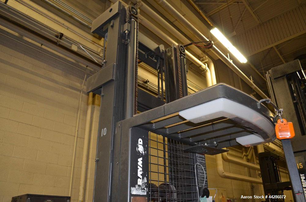Used- Raymond Model 550-0PC30TT, 3,000 Pound Capacity Electric Stand Up Riding Cherry Picker Style Lift 3,000 Pound Capacity...