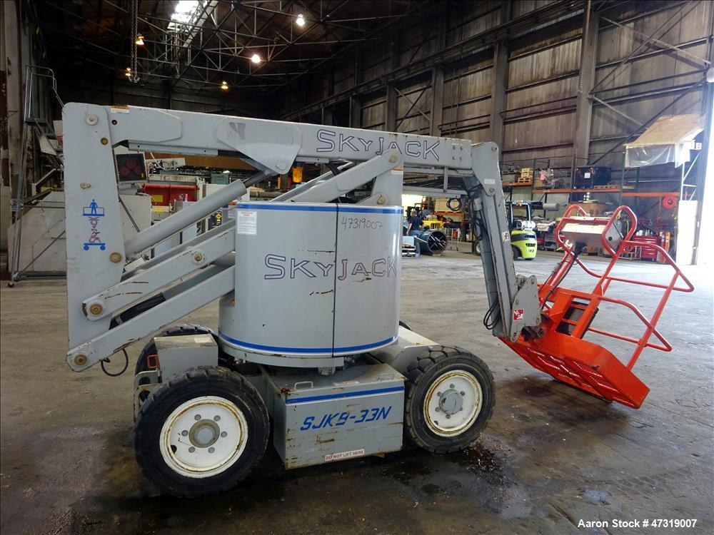 Used- SkyJack Articulated Boom Lift, Model SJK8-33W.