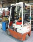 Used- Nissan 3 Wheel Sit Down Electric Forklift, Model OT30, Type E. 2700 Pound capacity, triple mast. Includes a charger.