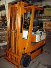 USED:Toyota electric rider fork truck. Approx overall size 7' long x 4' wide x 7' high. Mast: 4