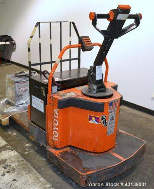 "Used- Toyota Walk Behind Electric Pallet Mover, Model 6HBE30. 6000 Pound capacity, 9"" wide x 49"" long forks. 24"" Load center..."