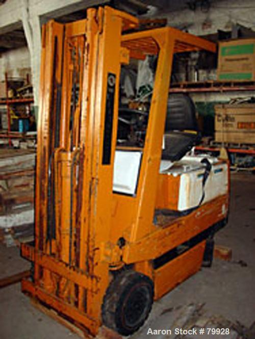 """USED:Toyota electric rider fork truck. Approx overall size 7' long x 4' wide x 7' high. Mast: 4"""" high. Forks: 3-1/2' long. H..."""