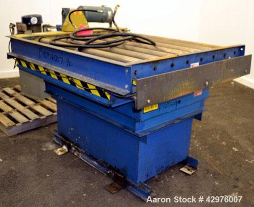 Used- Vestil Scissorlift, Model EHLTD-4848-4-70, Carbon Steel. 4000 Pound capacity. Includes 50'' wide powered roller convey...