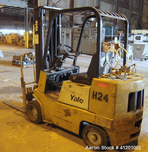 "Used- Yale Lift Truck, Model GLC040ADJUAE083, 4000 lb capacity. Triple mast with 5 degree backtilt, solid tire. (2) 42"" long..."