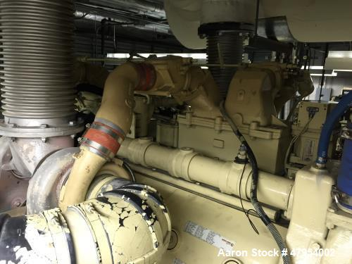 Used- Detroit 1000 kW diesel generator set. Open skid unit.