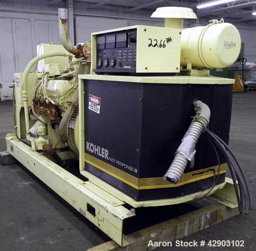 Used- Kohler 90kW continuous rated natural gas generator set.Kohler model 100RZ288, SN-299191. Ford model LSG-8751-6005-A en...