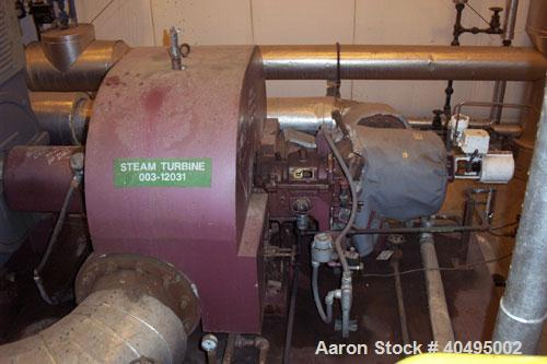 Used-Dresser Rand 850kW steam turbine generator set. 3/60/4160V Louis Allis gen end. Turbine frame 703HE, induction generato...