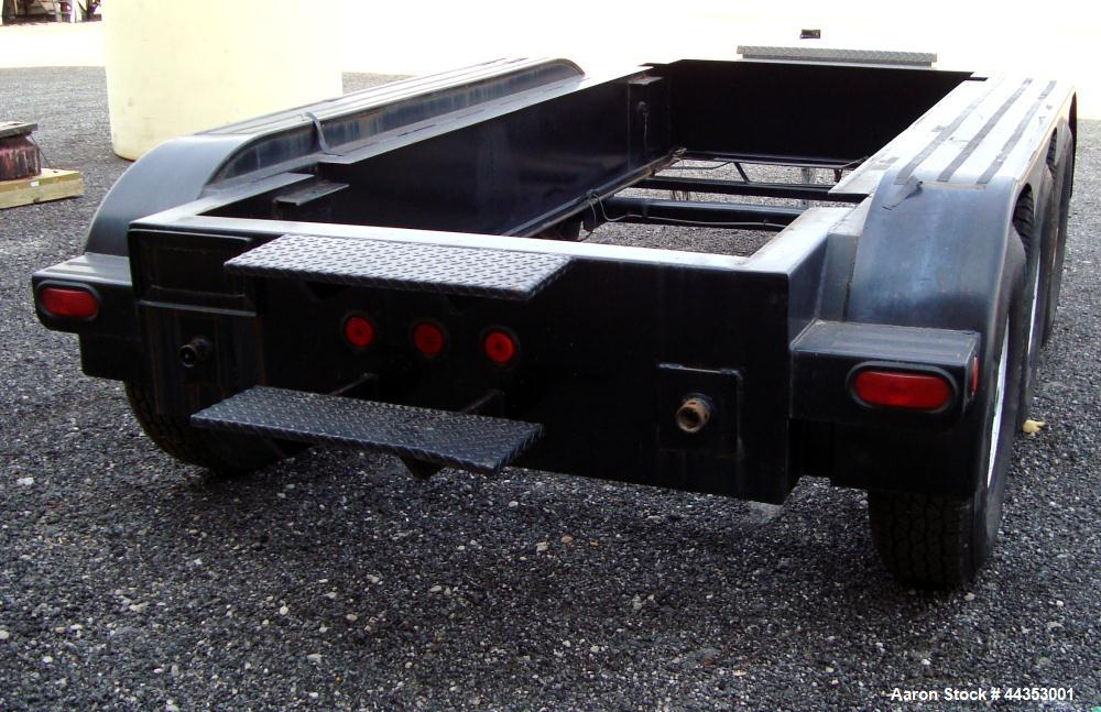 Used- Quality Welding Service 21,000 lb triple axle generator trailer with no fuel tank. New in 1999.