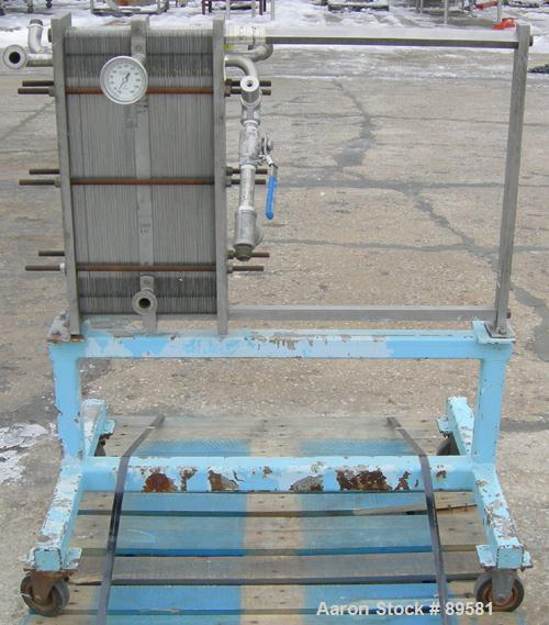 "USED: Plate heat exchanger, approximately 40 square feet, 316 stainless steel. 2 sections, (92) approximately 2-3/4"" wide x ..."