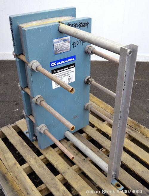 Used- Alfa Laval Thermal Plate Exchanger, 59.25 Square Feet, Model M10-MFG. (25) 316 Stainless steel plates. Designed 150 ps...