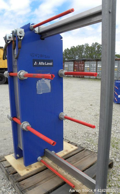 Used- Alfa Laval Thermal Plate Exchanger, 387.1 square feet, model M15-BFG. (58) Approximately 20-1/2'' wide x 60'' tall x 0...