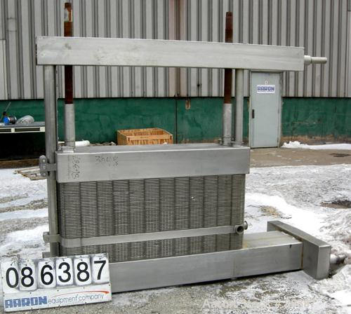 "Used- APV Crepaco Plate Heat Exchanger, Model CR5, 1410 Square Feet, 304 Stainless Steel. (98) approximately 16"" wide x 61"" ..."