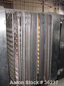 "Used- APV Plate Heat Exchanger, Model HX, Stainless Steel. Approximately 70 square feet. (54) 9"" wide x 34"" long plates. 24-..."