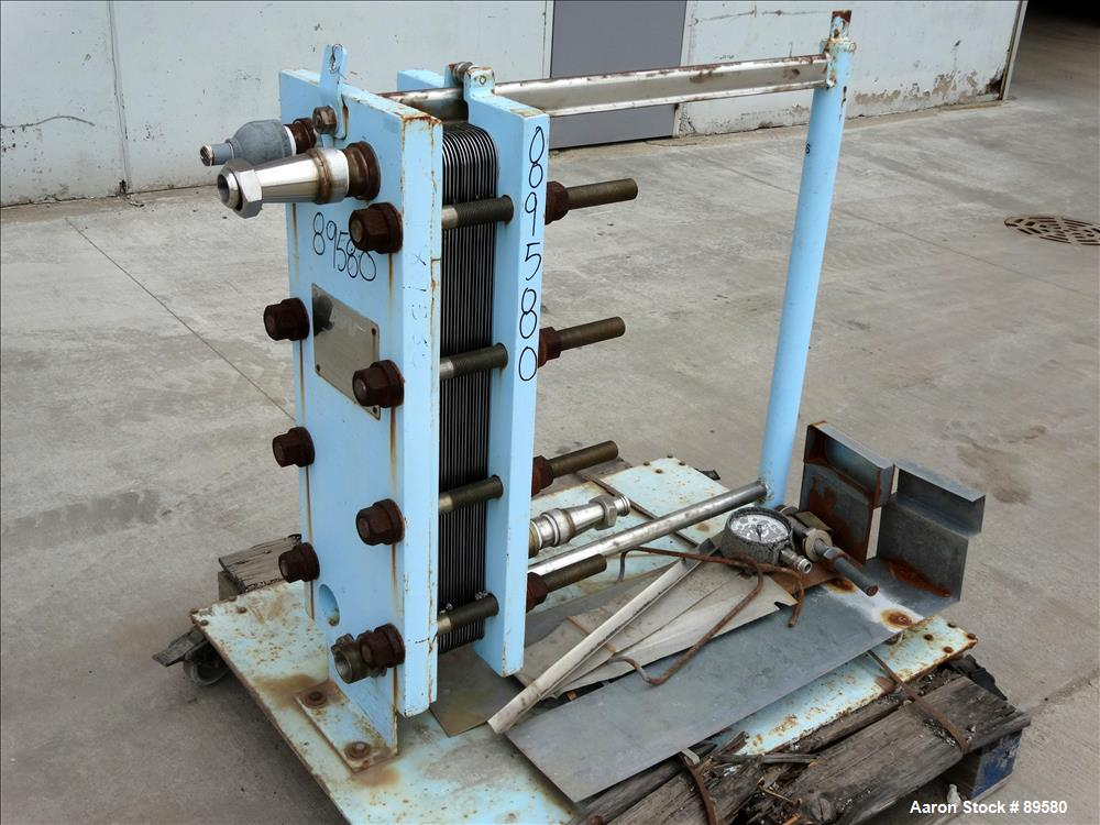 Used- Stainless Steel APV Plate Heat Exchanger, Model HXU-8, Approximately 19 Sq