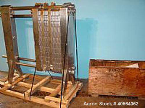 Used- APV R51 Royal Paraflow Stainless Steel Plate Heat Exchanger. Approximate 400 square feet. Mounted on unit (59) stainle...