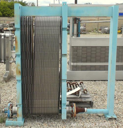 """Used- APV Plate Heat Exchanger, Approximately 878 Square Feet, Model R57, 316 Stainless Steel. (61) 16"""" wide x 60"""" tall plat..."""