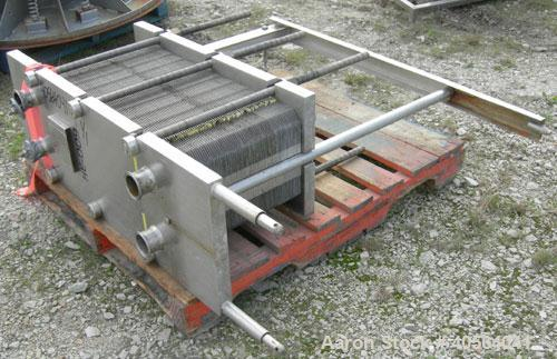 "Used- APV Plate Heat Exchanger, Model SR20, 304 stainless steel. Approximately 215 square feet. (129) approximate 12"" wide x..."