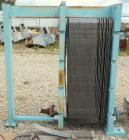 Used- APV Plate Heat Exchanger, Approximately 878 Square Feet, Model R57, 316 Stainless Steel. (61) 16